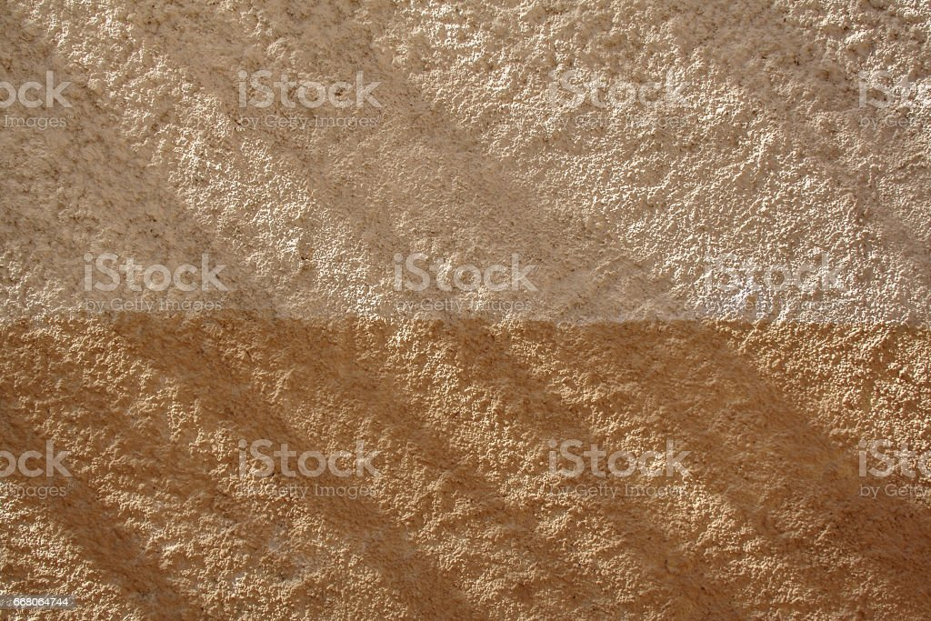 medieval stone wall of old building in sunny day With a shadow falling on it stock photo