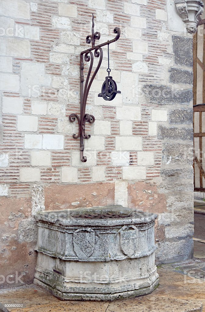 Medieval stone well in Troyes stock photo