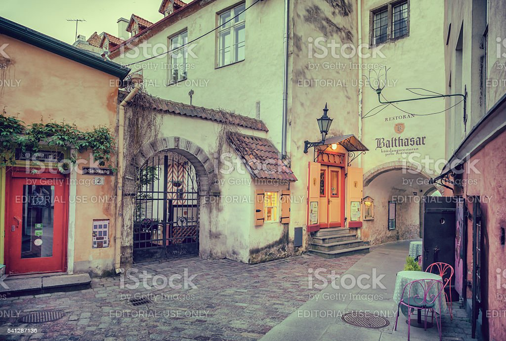 Tallinn, Estonia - May 30, 2016: medieval street and restaurant stock photo