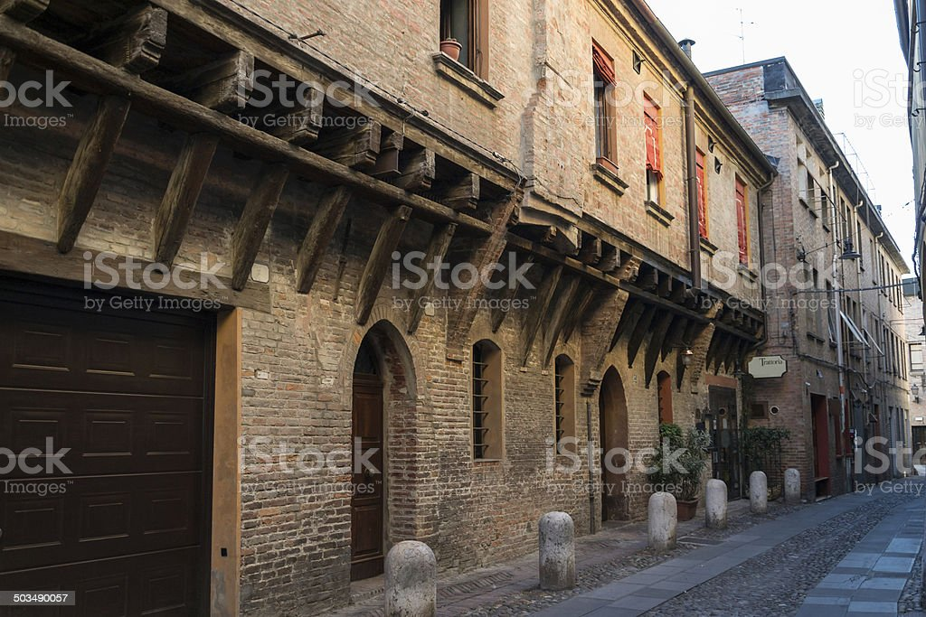 Medieval street in Ferrara with a Trattoria stock photo