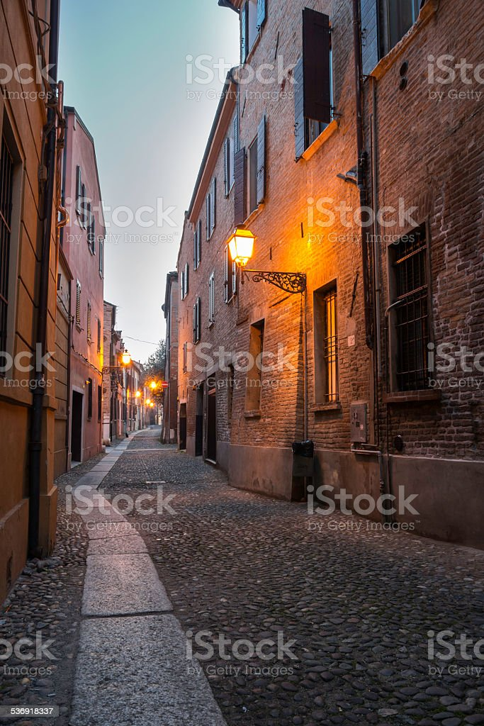 Medieval street in the downtown of Ferrara city stock photo