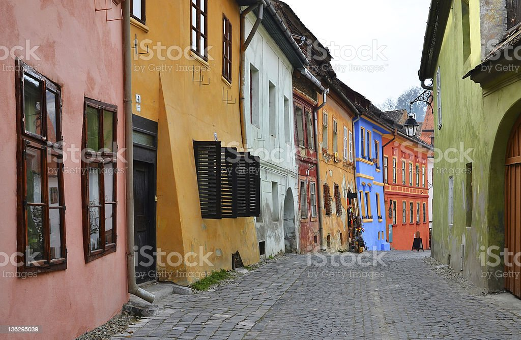 Medieval street view in Sighisoara, Romania stock photo