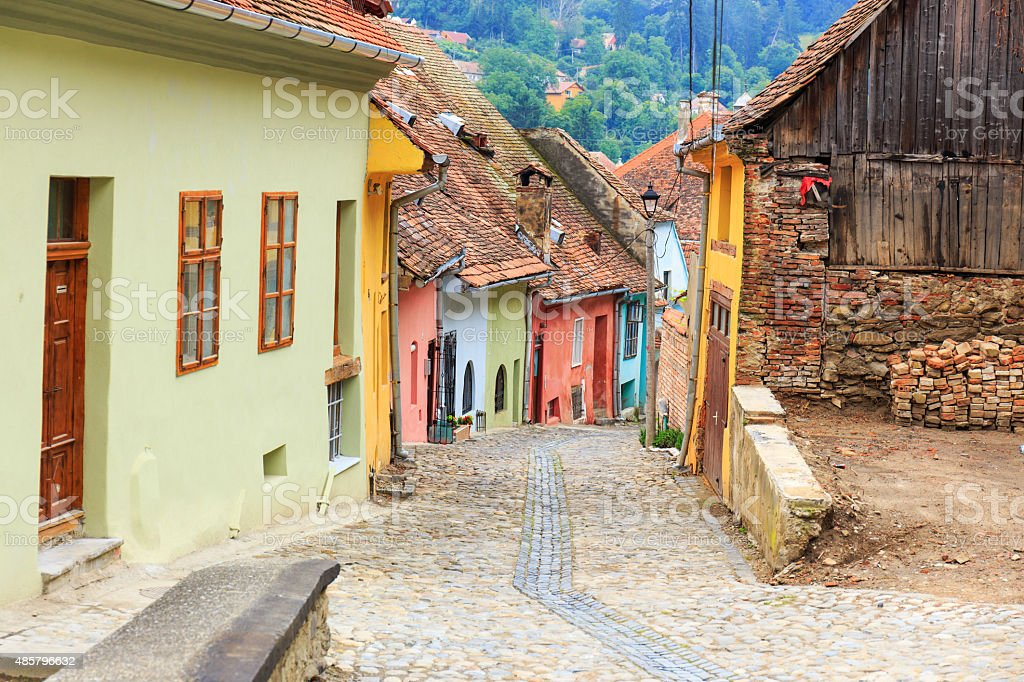 Medieval street view in Sighisoara , Romania stock photo
