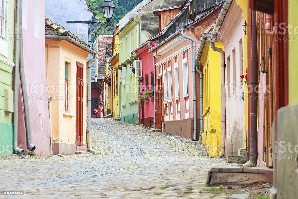 Medieval street view in Sighisoara , Romania stock photo