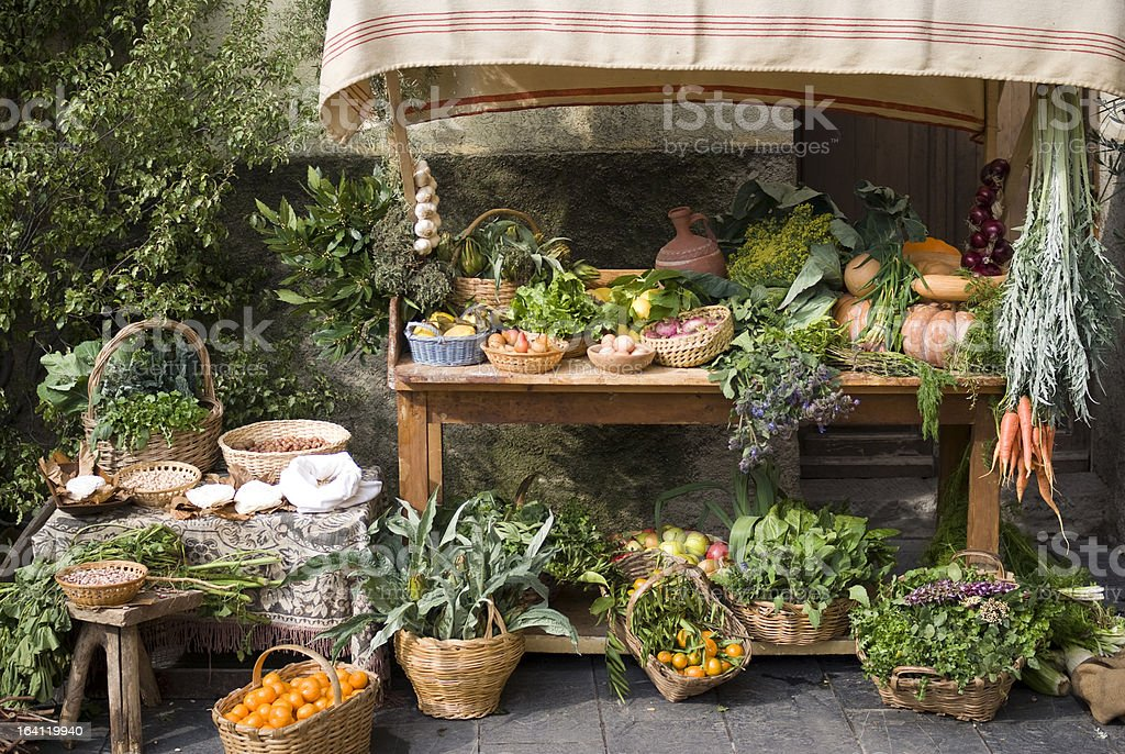Medieval style market stalk selling all fresh produce stock photo