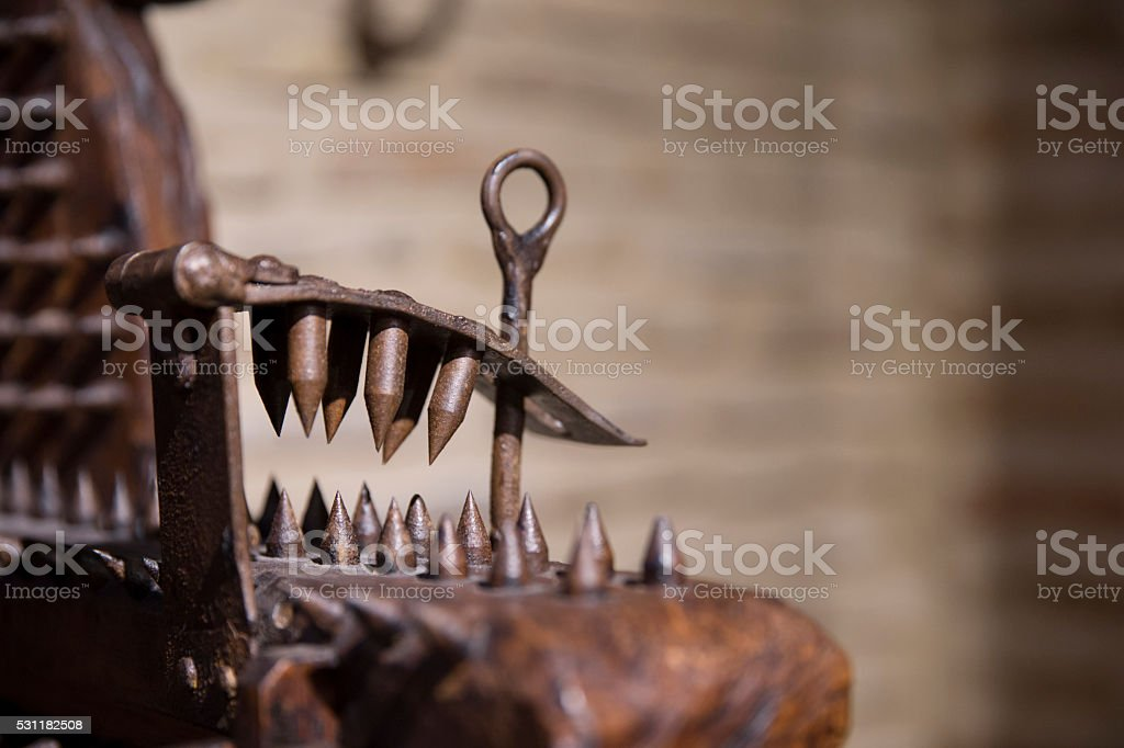 Medieval torture chair detail stock photo