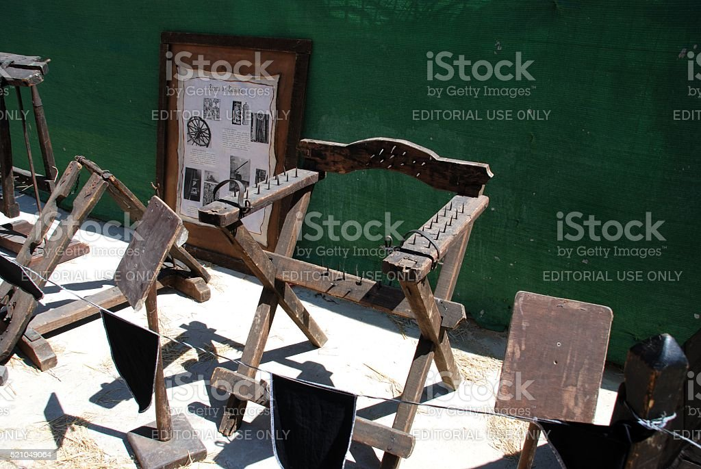 Medieval torture chair with spikes, Spain. stock photo