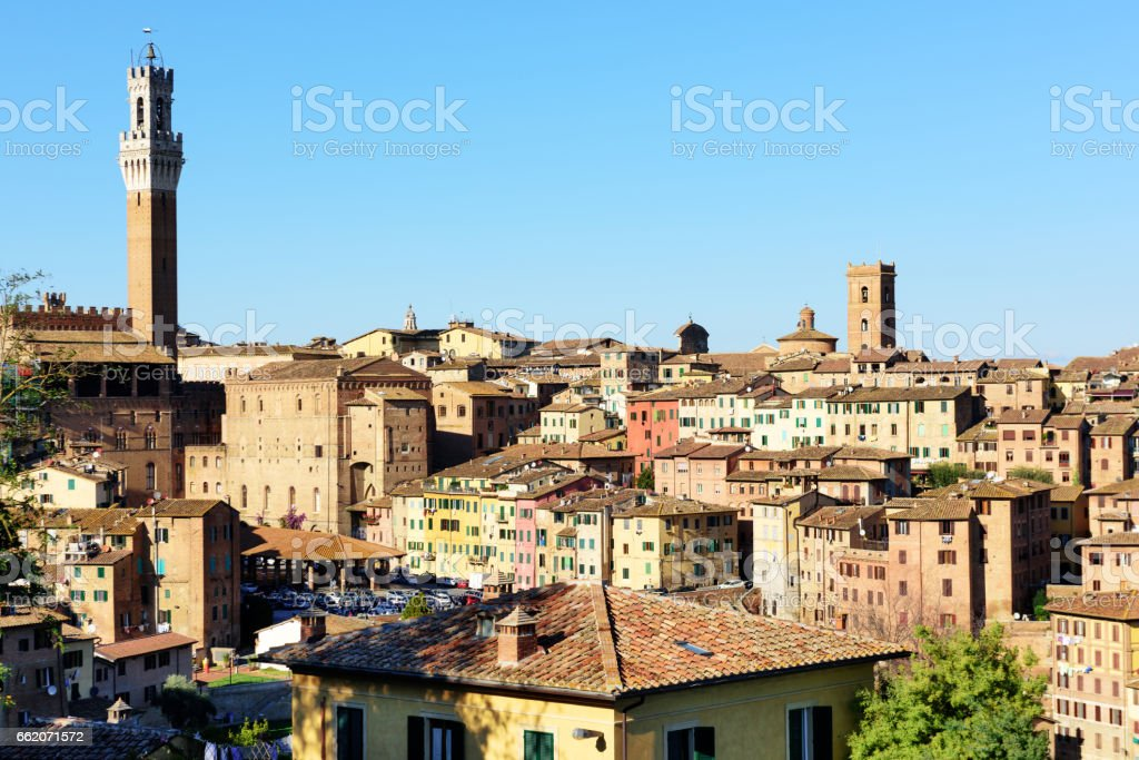Medieval Tower and Old Town, Siena, Italy stock photo