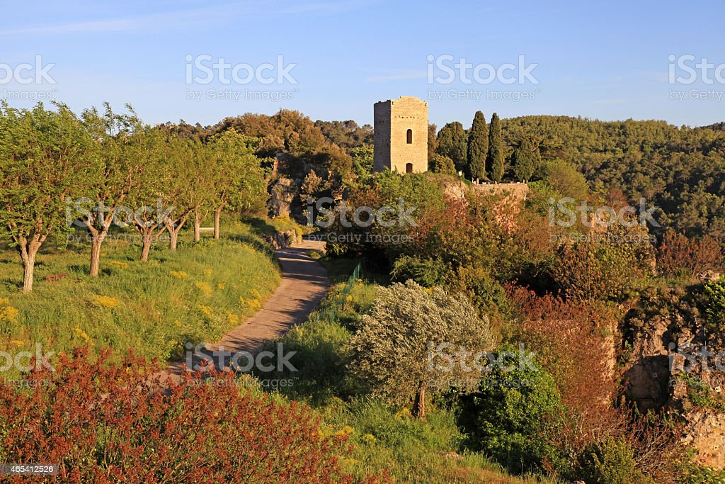 medieval tower in village with rural landscape, Provence stock photo