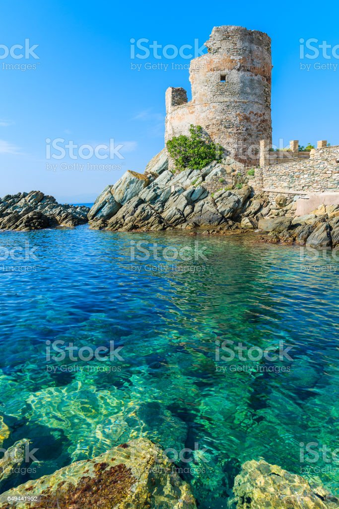 Medieval tower on coast of Corsica island in Erbalunga town, France stock photo
