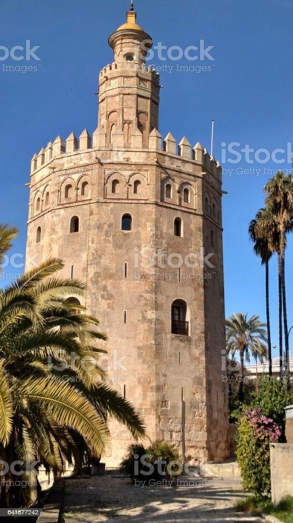Medieval tower Torre de Oro along Guadalquivir River Seville Spain stock photo