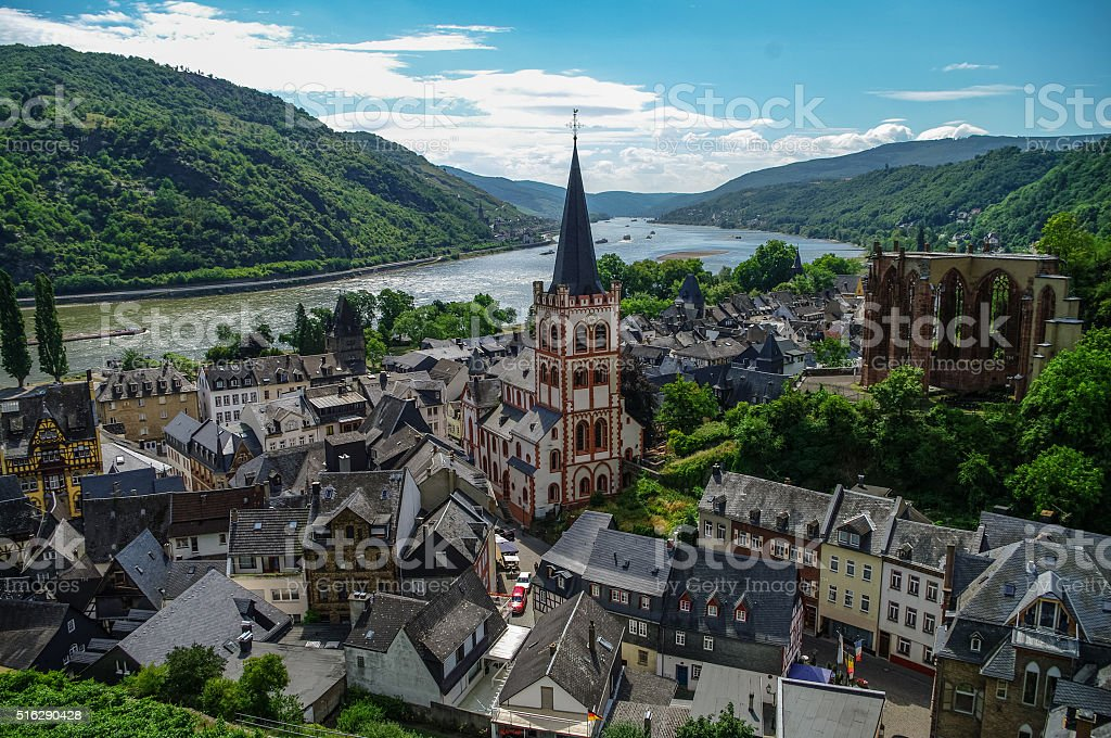 Medieval village Bacharach. City panorama from hill, covered by stock photo