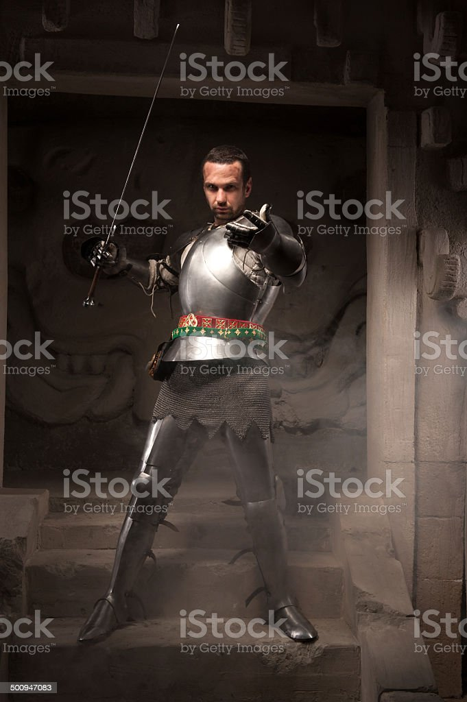 Medieval warrior posing on steps of ancient temple stock photo