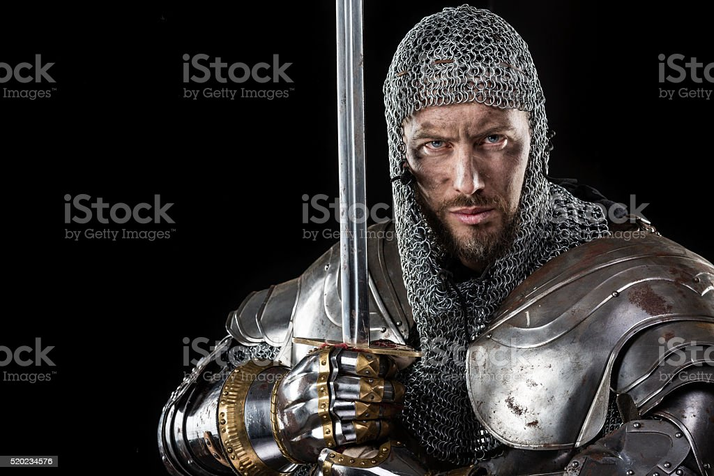 Medieval Warrior with Chain Mail Armour and Sword stock photo