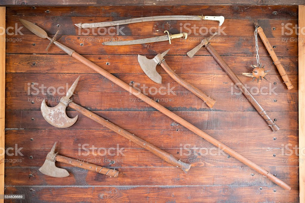 Medieval weapons on wooden board stock photo