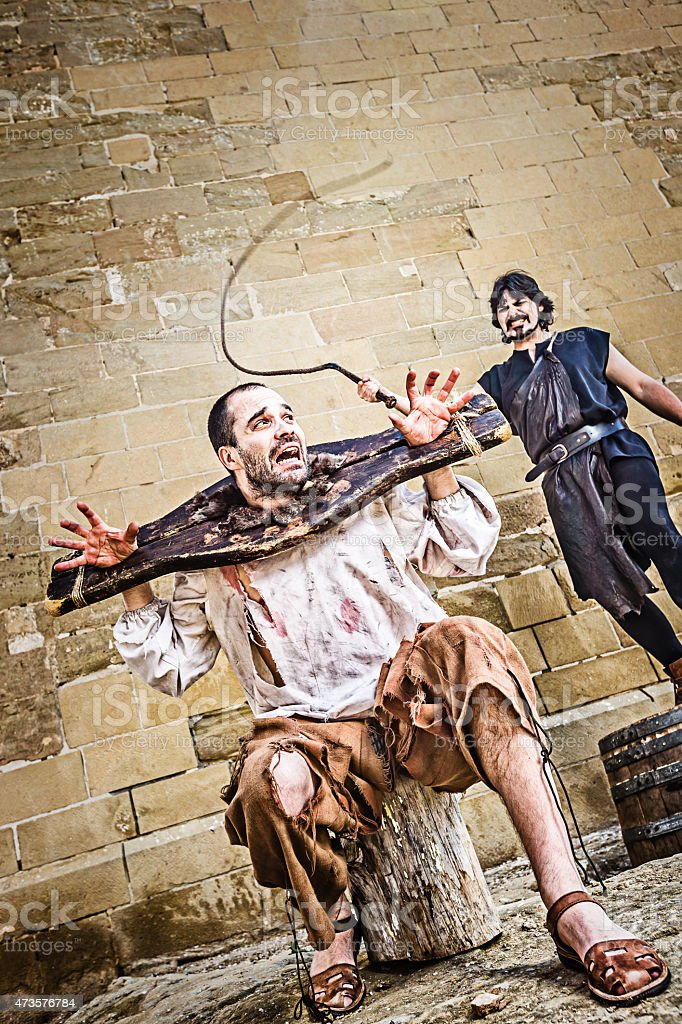 Medieval whipping torture stock photo