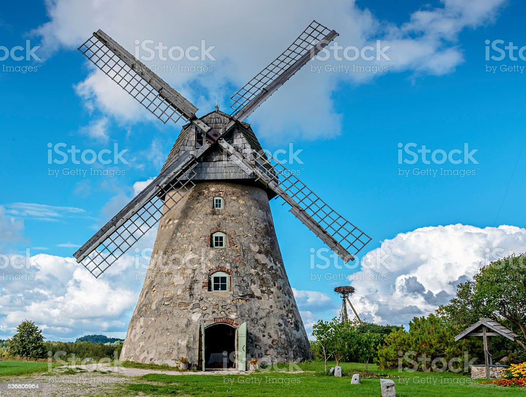 Medieval windmill in bright summer day,Latvia stock photo