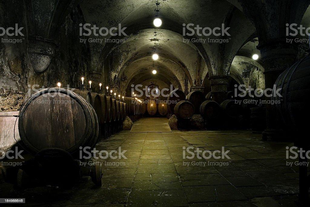 Medieval wine cellar - illuminated barrels stock photo
