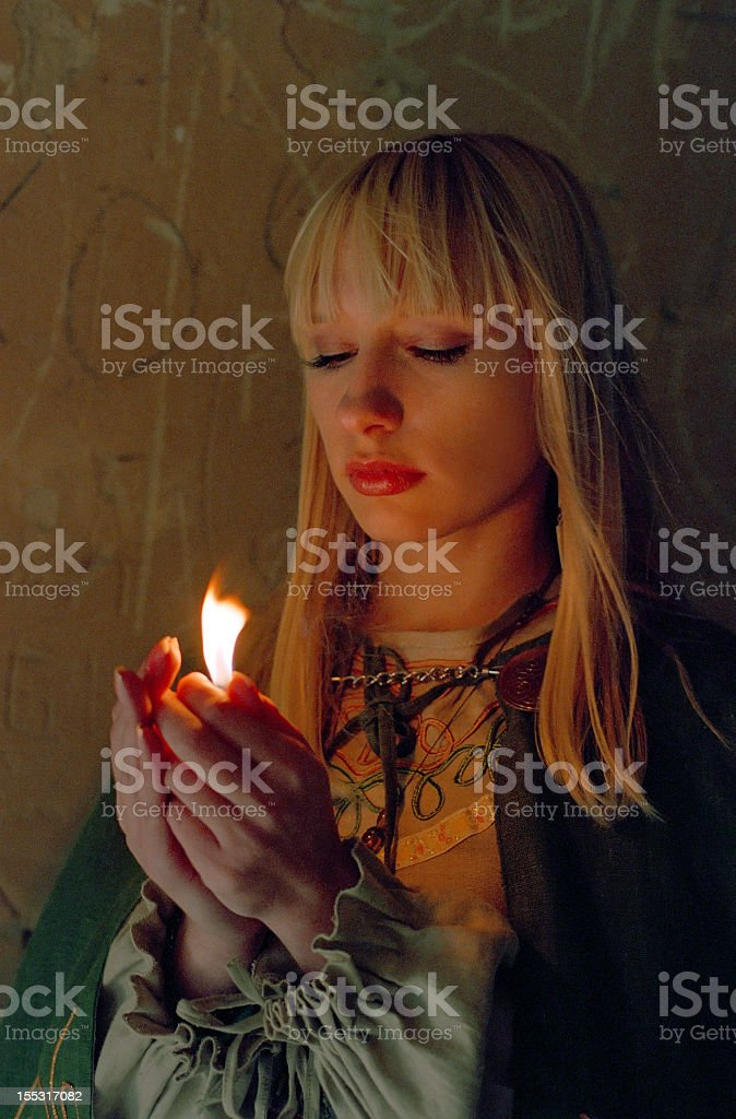 medieval woman holding fire in hands royalty-free stock photo