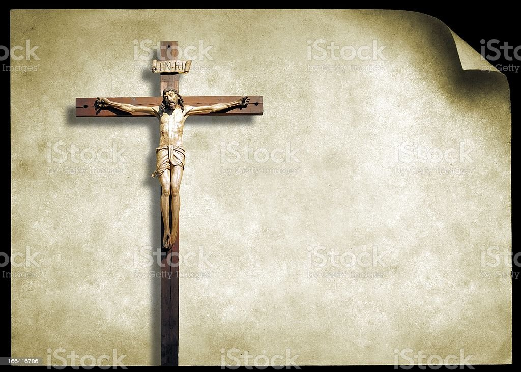 Medieval wooden crucifix on old paper royalty-free stock photo