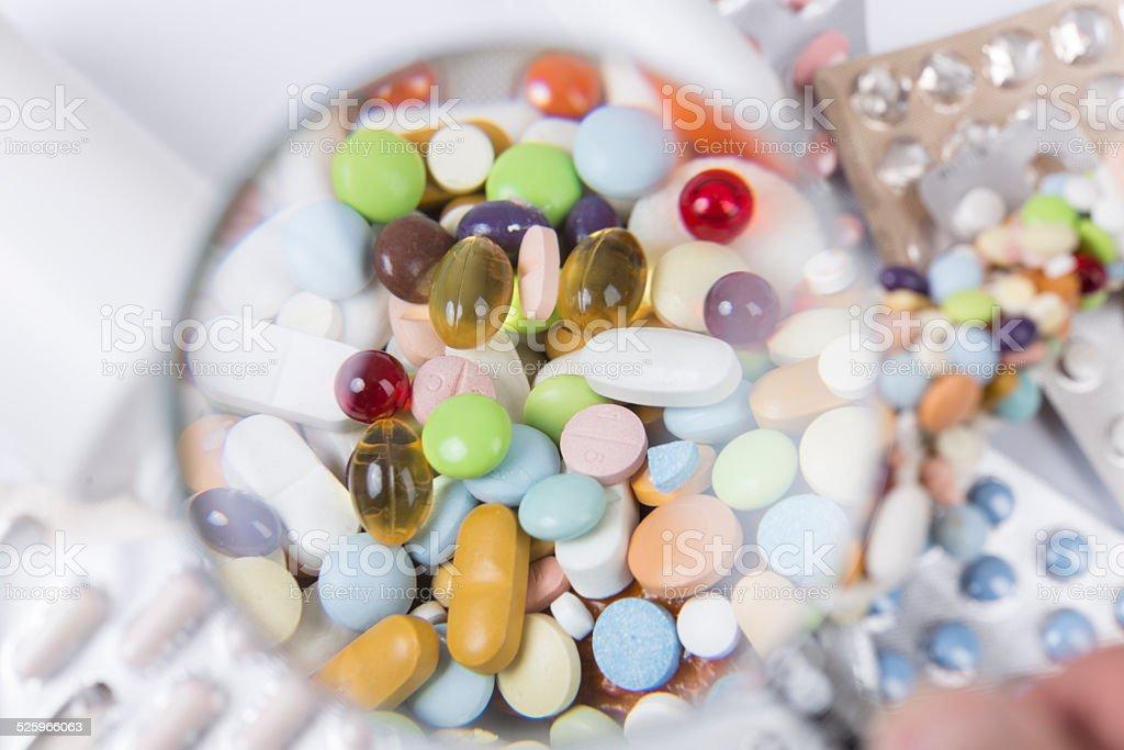 Medikamente unter Vergrößerungsglas, Freiburg, Deutschland stock photo