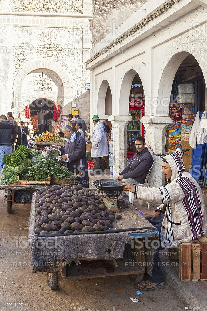Medina street with people walking, sellers and lot of shops stock photo