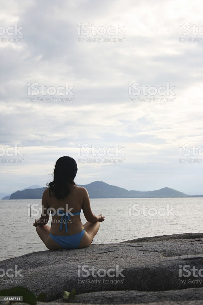 Meditates by the beach royalty-free stock photo