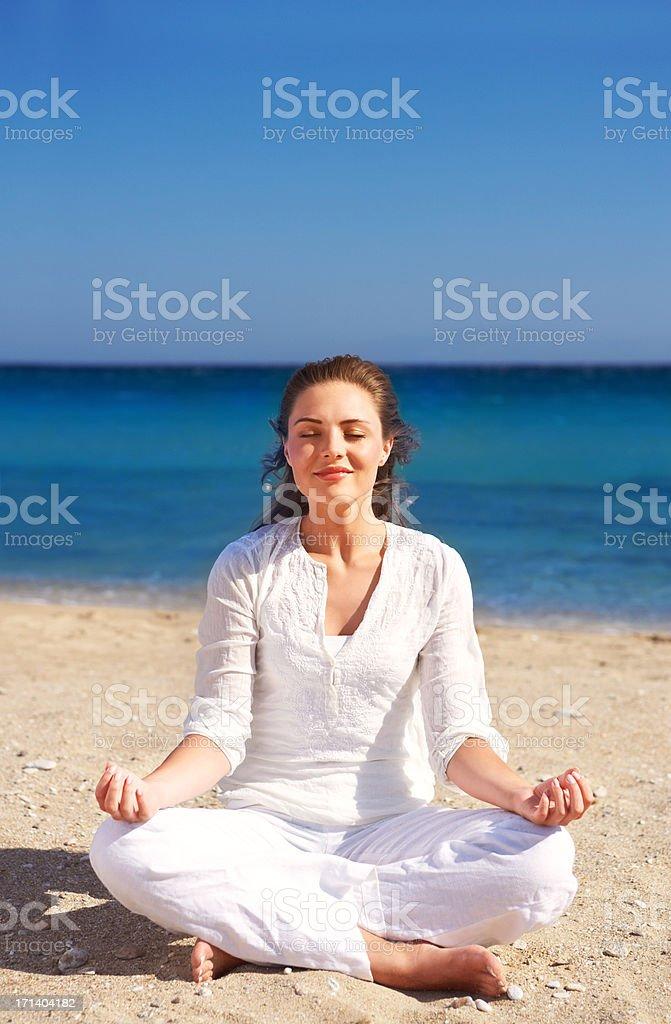 Meditating at the beach royalty-free stock photo