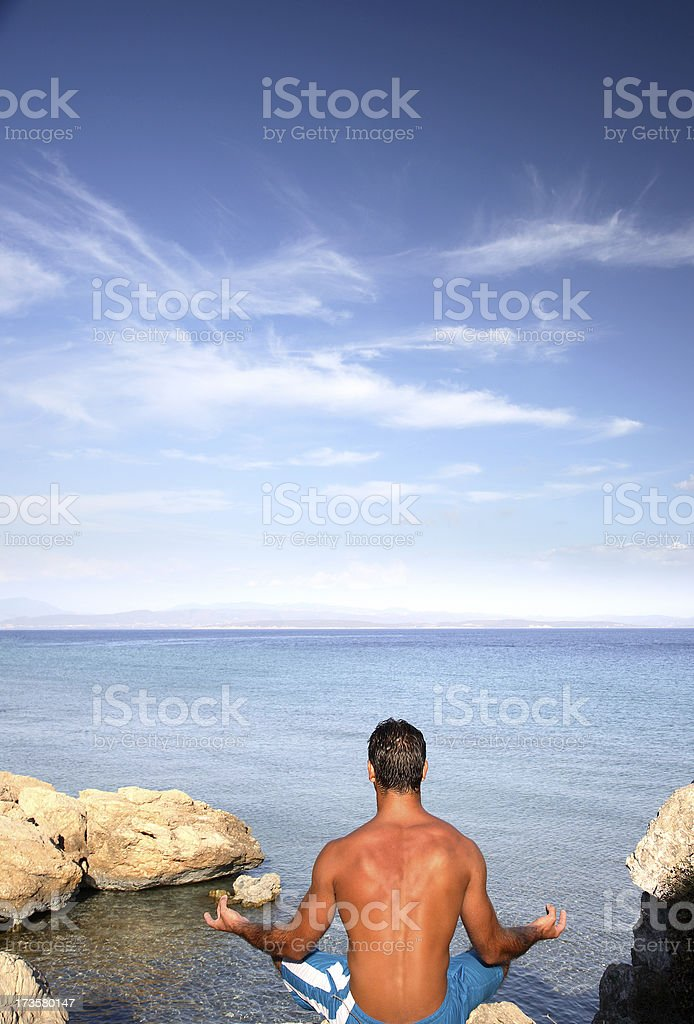 Meditating at the beach royalty-free stock photo