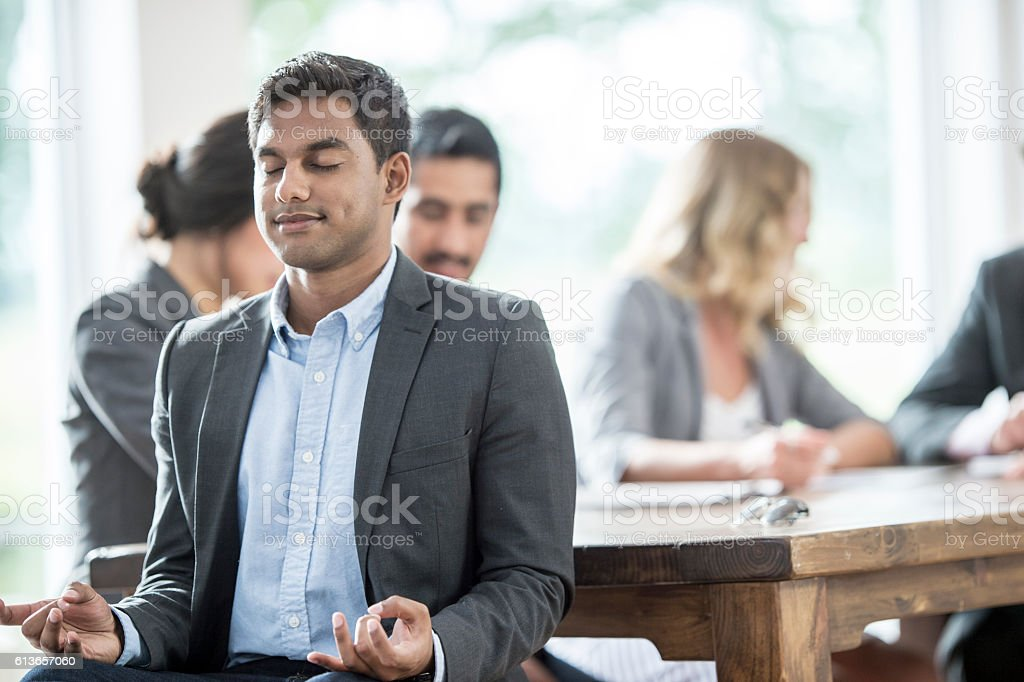 Meditating at the Office stock photo
