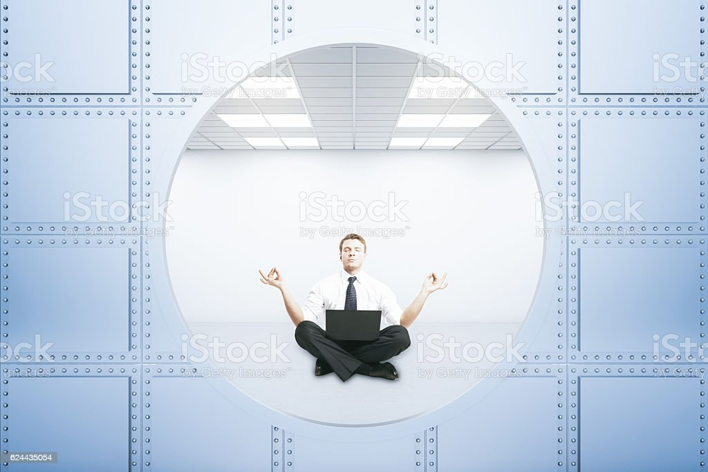 Meditating businessman stock photo