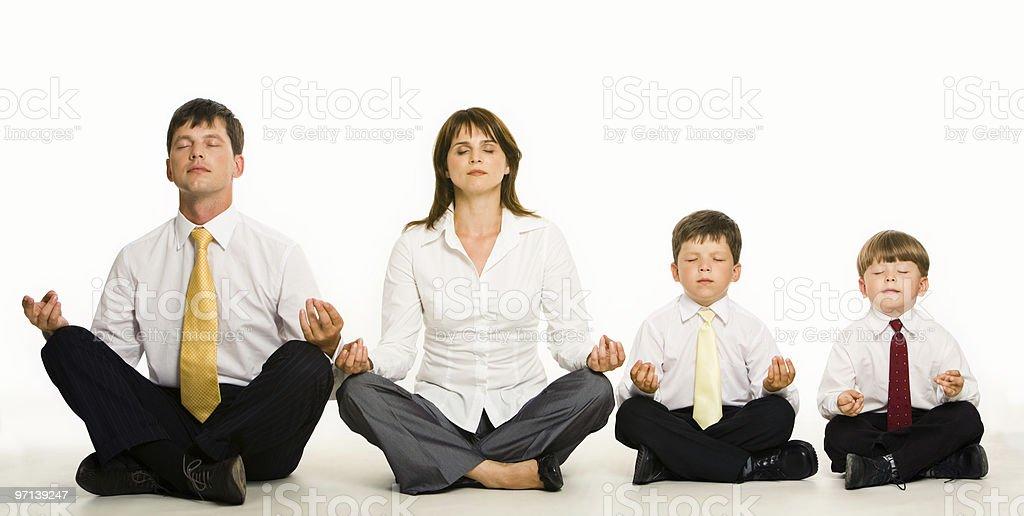 Meditating family royalty-free stock photo