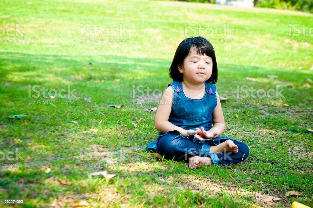 Meditating girl stock photo