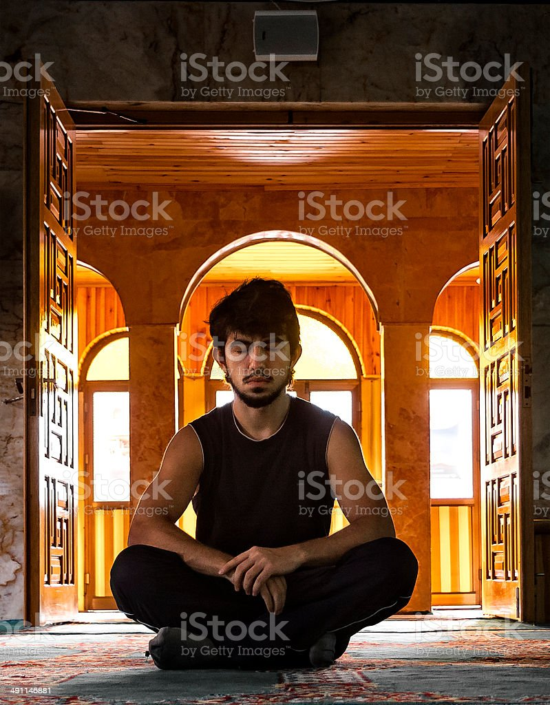 Meditating in the Mosque royalty-free stock photo