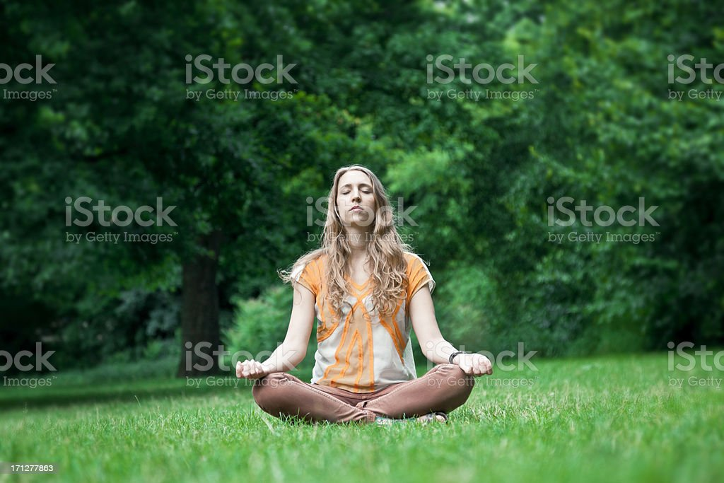 Meditating in the Park royalty-free stock photo