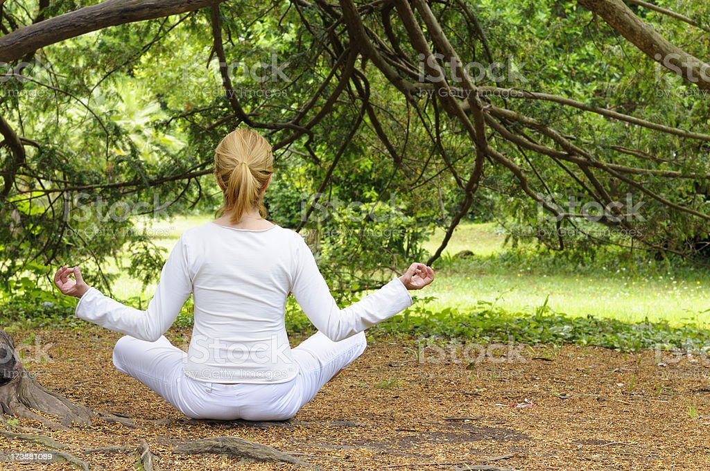 Meditating royalty-free stock photo