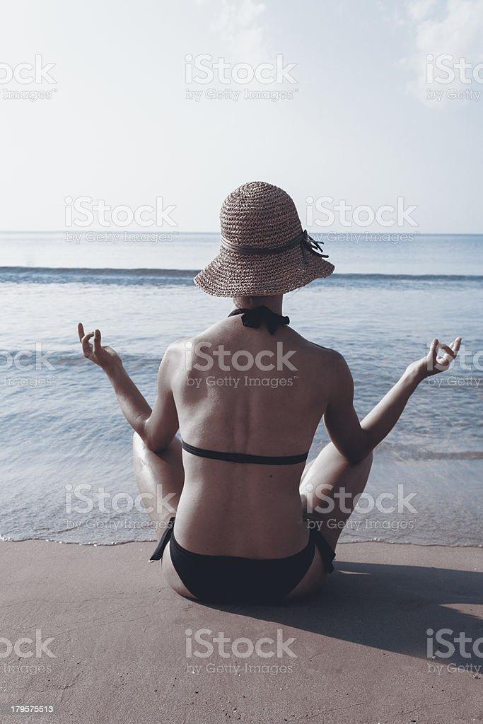 Meditating royalty-free stock photo