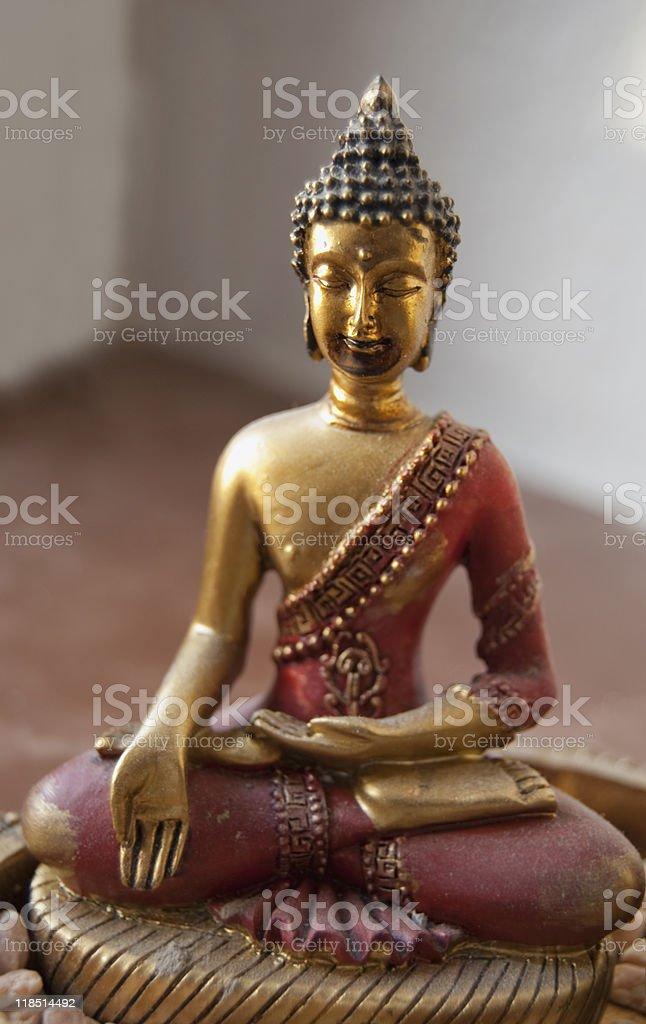 meditating red buddha stock photo