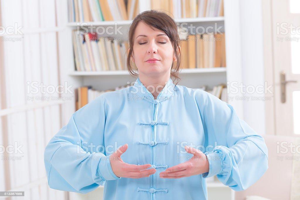 Meditating woman stock photo