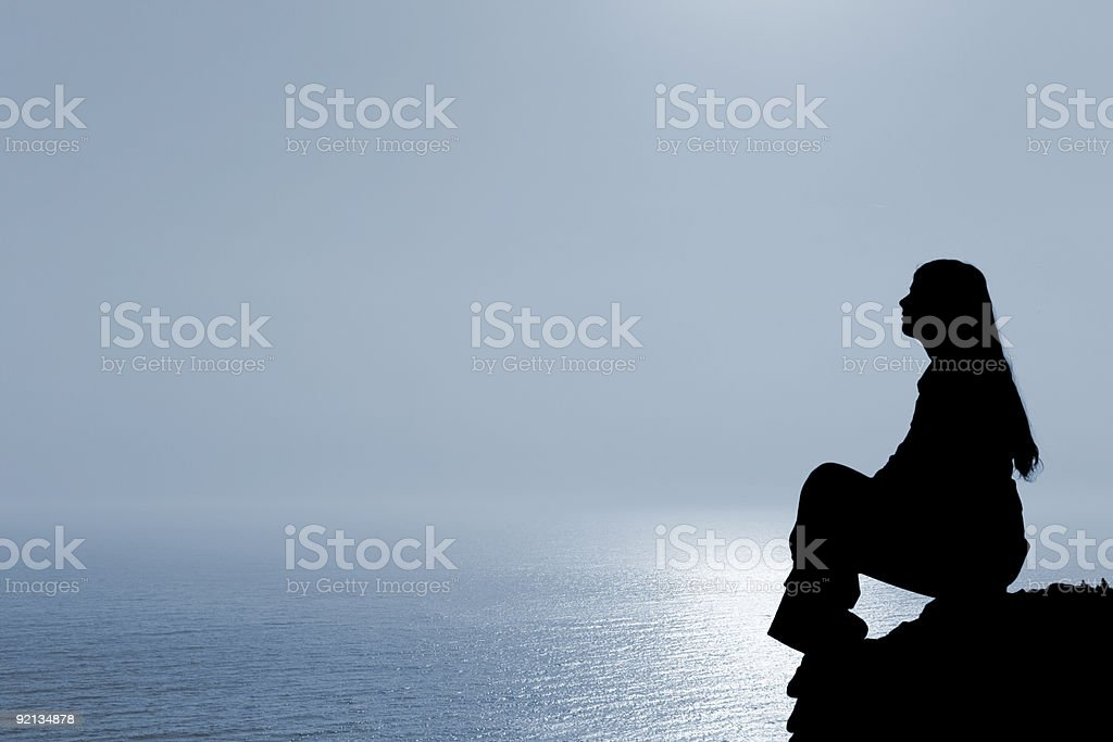 Meditating woman stock photo