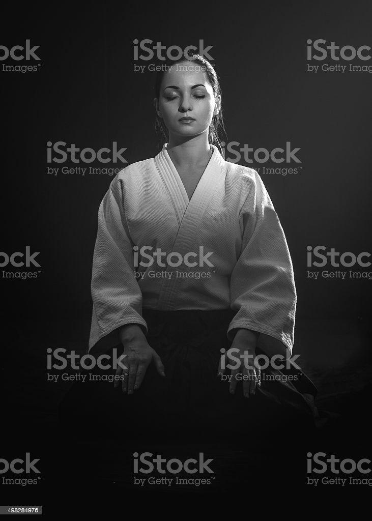 Meditating young woman stock photo