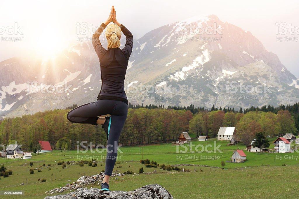 Meditation and balance exercise in beautiful nature mountin landscape stock photo