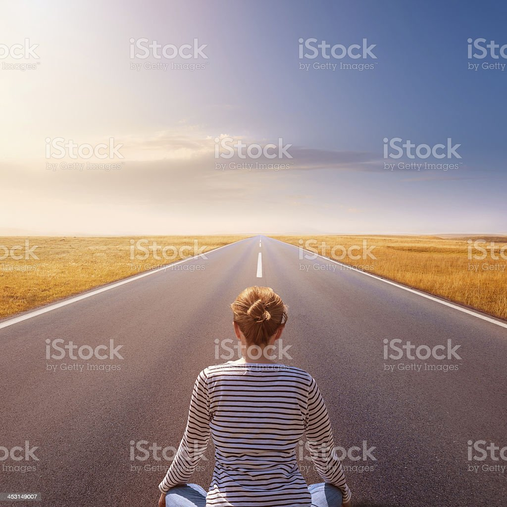 Meditation and relaxation on an empty road stock photo