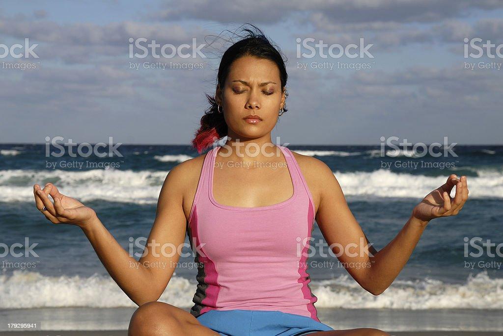 Meditation and Yoga (Lotus Pose) on the Beach royalty-free stock photo