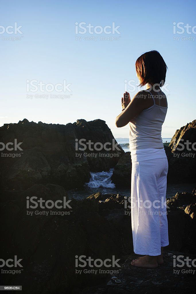 Meditation at the beach stock photo