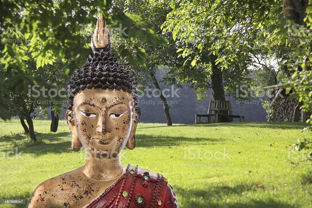 Meditation: Buddha figurine in a zen garden. royalty-free stock photo