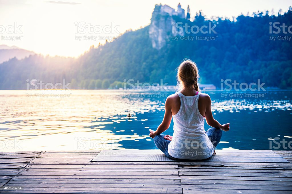 Meditation by the lake stock photo