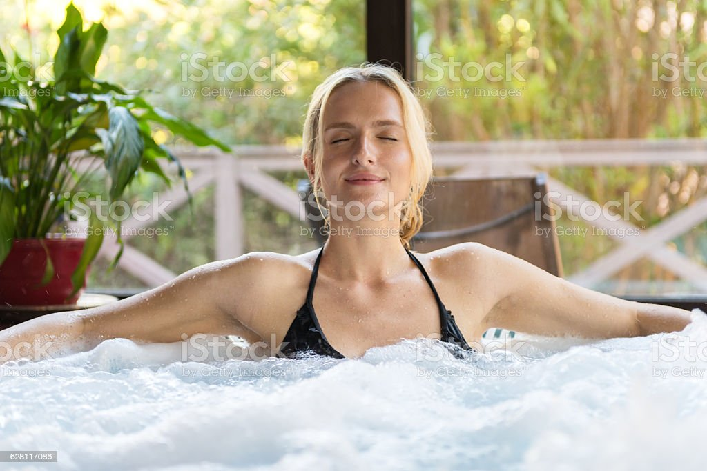 Meditation in jacuzzi stock photo