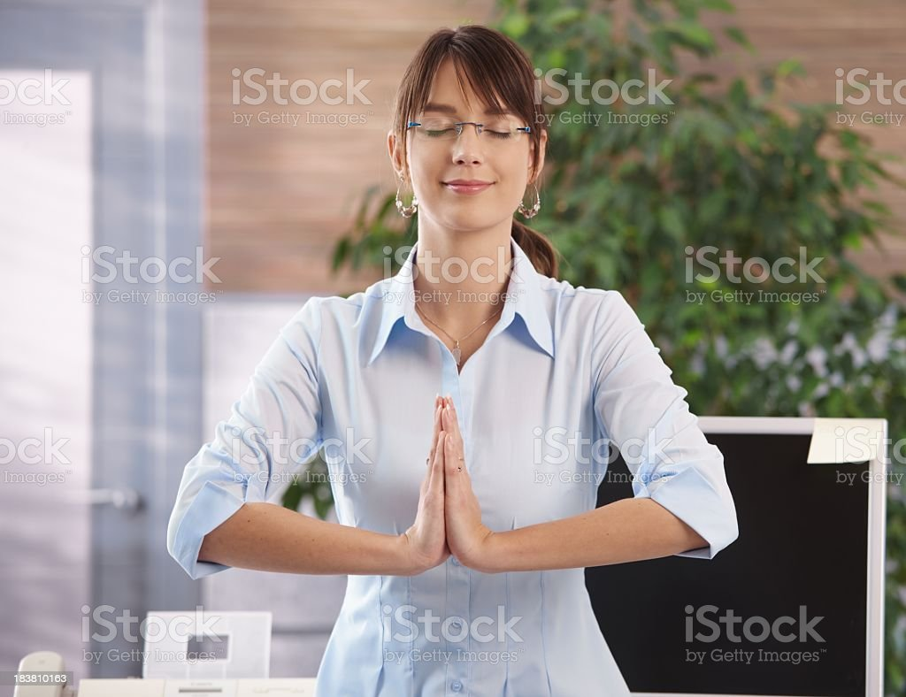 Meditation in office royalty-free stock photo