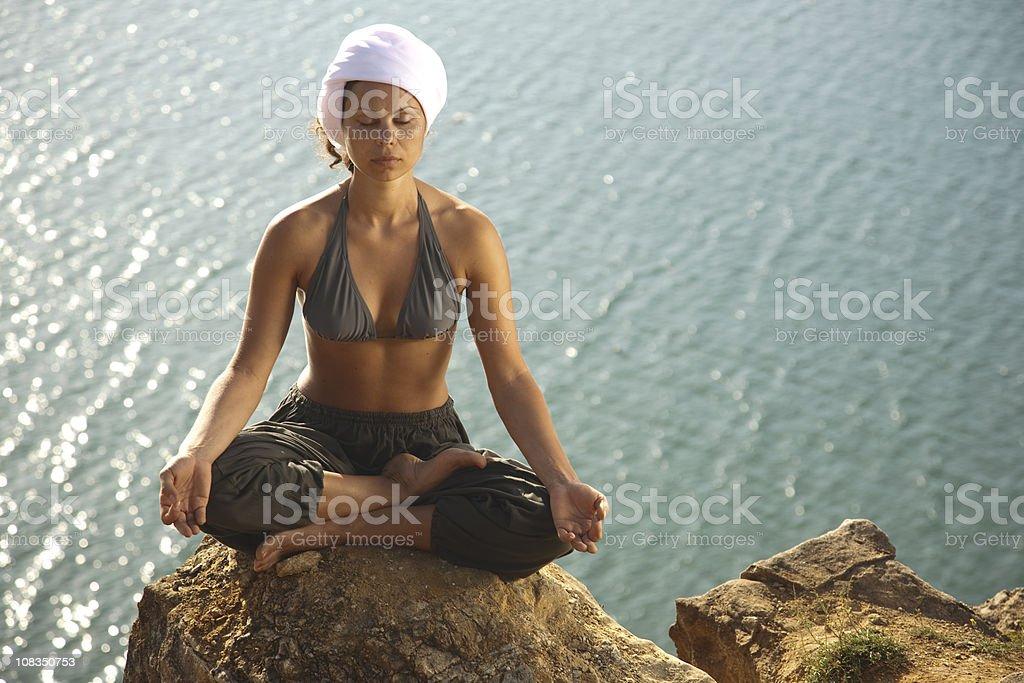Meditation near the sea royalty-free stock photo